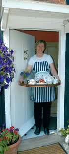 Elizabeth serving afternoon tea